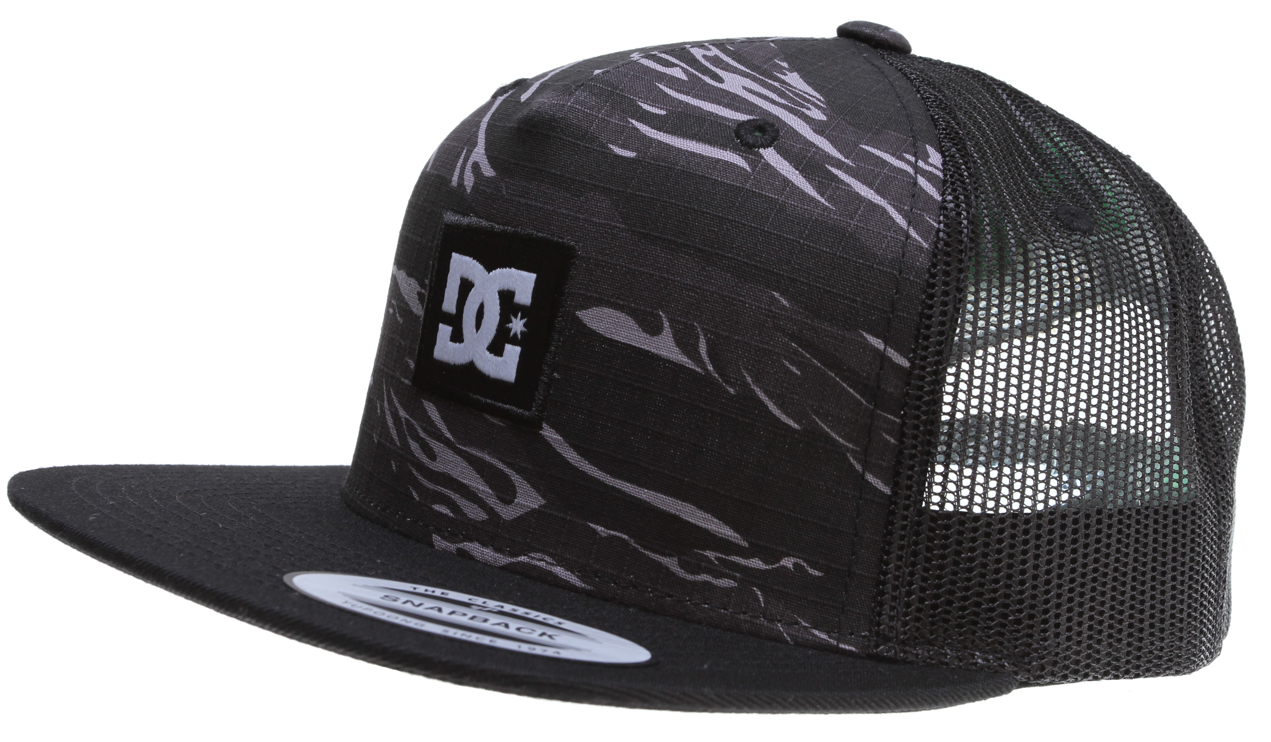 Skateboard Key Features of the DC Pleaser Cap: Structured 5 Panel Trucker Cap Mixed Fabrications on Crown Woven Label Patch at Front Woven Label At Back 50% Polyester / 45% Acrylic / 5% Wool - $12.95
