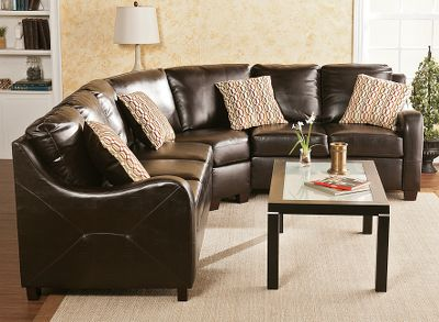 Entertainment The Monty Three-Piece Sectional is upholstered in chocolate synthetic leather, offering the look and feel of leather without the price. Scooped arms provide design and comfort, while the sides feature lovely stitched details. Its easy to assemble in approximately five minutes without tools. Connecting brackets simply click into place. Moving or rearranging it is easy and convenient. The style of this sectional complements homes with transitional to modern dcor. Set includes sofa, love seat, wedge and four 16 x 16 toss pillows. Imported.Entire sectional together at 90 angle: 112L x 93W x 35H.Sofa section: 72.5L x 34W x 35H.Love seat section: 52.5L x 33.5W x 35H.Wedge section: 61L x 33W x 35H. - $1,729.99