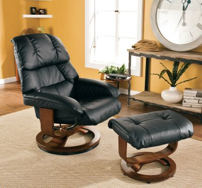 Entertainment Surround yourself in the comfort and luxury of this ergonomically designed bonded-leather chair and ottoman. The chair features a birch hardwood base with mechanism-glide system. Chair swivels 360 degrees and an adjuster knob locks the seat in any position for a precise, ergonomic fit. The chair and ottoman have a stain-resistant coating applied to the leather. The stylish design makes this set great for any room in the house. Constructed of birch hardwood, bonded leather, foam and metal hardware. Assembly required. Imported. Ottoman dimensions: 19.5L x 17.75W x 17.5H. Chair dimensions: 31L x 31W x 43.5H. Weight capacity: 300 lbs. Colors: Black, Brown, Taupe. Color: Brown. - $399.99