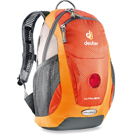 Camp and Hike The Deuter Ultra Bike kids' daypack lets them tote their own gear as you introduce them to the great outdoors. Airstripes back panel provides ventilation and padding to enhance comfort during activities. Padded shoulder straps are soft and nonirritating; sternum strap keeps pack secure. Hydration-compatible design can accommodate a 1 liter reservoir (not included); internal reservoir pocket and drink tube exit port allow on-the-go hydration. Main compartment fits a jacket, snacks and other daily essentials. Top front pocket keeps small items within easy access. Front of pack has a small, circular window to insert a safety light (not included) for increased visibility. Side mesh pockets hold water bottles (not included). Name tag inside. Closeout. - $20.83