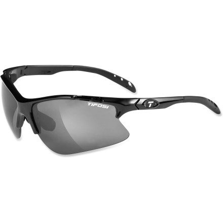 Golf Put on the Tifosi Roubaix interchangeable sunglasses before jumping on a bike or playing a round of golf. They include 3 sets of lenses designed to help you read terrain or spot a ball in flight. Frame includes 3 sets of interchangeable lenses (Smoke, Golf & Tennis(TM) gold and Extreme Contrast(TM) rose) to meet the demands of your active lifestyle. The Smoke lens is great for everyday activities when the sun is high and the sky is blue. The Golf & Tennis (GT) lens is designed to enhance your ability to pick up a ball in flight by balancing target and background brightness. Use the Extreme Contrast (EC) lens to increase light contrast so you can spot subtle breaks on a putting green or your desired line down a single-track mountain bike trail. Lightweight and virtually shatterproof, polycarbonate lenses are 20 times more impact resistant than glass and one-third the weight. Grilamid(R) TR90 lightweight nylon frames offer a consistent fit and flexibility in all temperatures and are extremely impact resistant. Hydrophilic rubber nosepiece and temple ends become tackier when wet for reliable grip during exercise and hot weather; ear pieces bend for a custom fit. Ventilated lenses increase airflow to help eliminate fogging; lenses block 100% of harmful UVA and UVB light. Tifosi Roubaix interchangeable sunglasses fit large to extra large faces. Semirigid carrying case and cleaning cloth included. Overstock. - $39.73