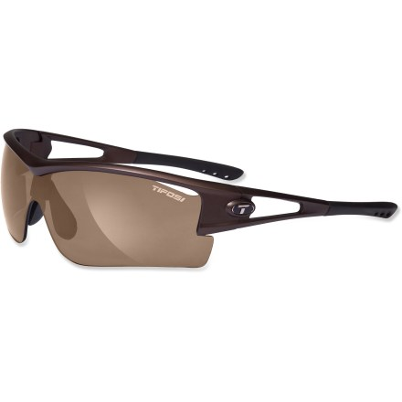 Golf The Tifosi Logic XL sunglasses have a sport design and broad coverage with 3 sets of lenses to accommodate you and your adventures, from a round of golf to a hike to a thrilling bike ride. Frame includes 3 sets of interchangeable lenses (Brown, Extreme Contrast(TM) rose and Golf & Tennis(TM) gold) to meet the demands of your active lifestyle. The Brown lens is great for everyday activities when the sun is high and the sky is blue. Use the Extreme Contrast (EC) lens to increase light contrast so you can spot subtle breaks on a putting green or your desired line down a single-track mountain bike trail. The Golf & Tennis (GT) lens is designed to enhance your ability to pick up a ball in flight by balancing target and background brightness. Lightweight and virtually shatterproof, polycarbonate lenses are 20 times more impact resistant than glass and one-third the weight. Grilamid(R) TR90 lightweight nylon frames offer a consistent fit and flexibility in all temperatures and are extremely impact resistant. Hydrophilic rubber nosepiece and temple ends become tackier when wet for reliable grip during exercise and hot weather; ear and nose pieces bend for a custom fit. Ventilated lenses increase airflow to help eliminate fogging; lenses block 100% of harmful UVA and UVB light. Tifosi Logic XL interchangeable sunglasses fit large to extra-large faces. Semirigid carrying case and cleaning cloth included. Overstock. - $39.73