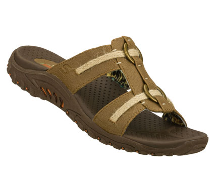Surf Relax and enjoy the warm temps with the SKECHERS Reggae - Lion Zion sandal.  Smooth faux leather upper in a two strap slide casual comfort sandal with stitching and overlay accents. - $49.00