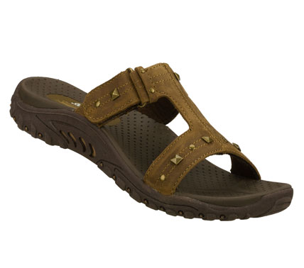 Surf Ease into all your warm weather looks wearing the SKECHERS Reggae - Studded Rockfest sandal.  Smooth oiled leather upper in a two strap casual comfort slide sandal with stitching and metal stud accents. - $55.00