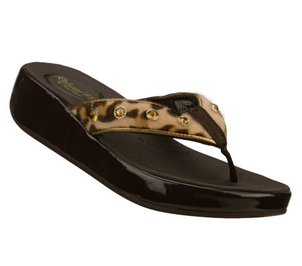 Surf Combine visual interest with blissful comfort in the SKECHERS Relaxed Fit: Upgrades - Traditions sandal.  Soft fur-textured fabric upper with solid or animal print design in a comfort thong sandal with stitching accents and gem detail. - $50.00