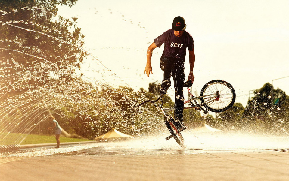 BMX bmx skills over water sprinkler