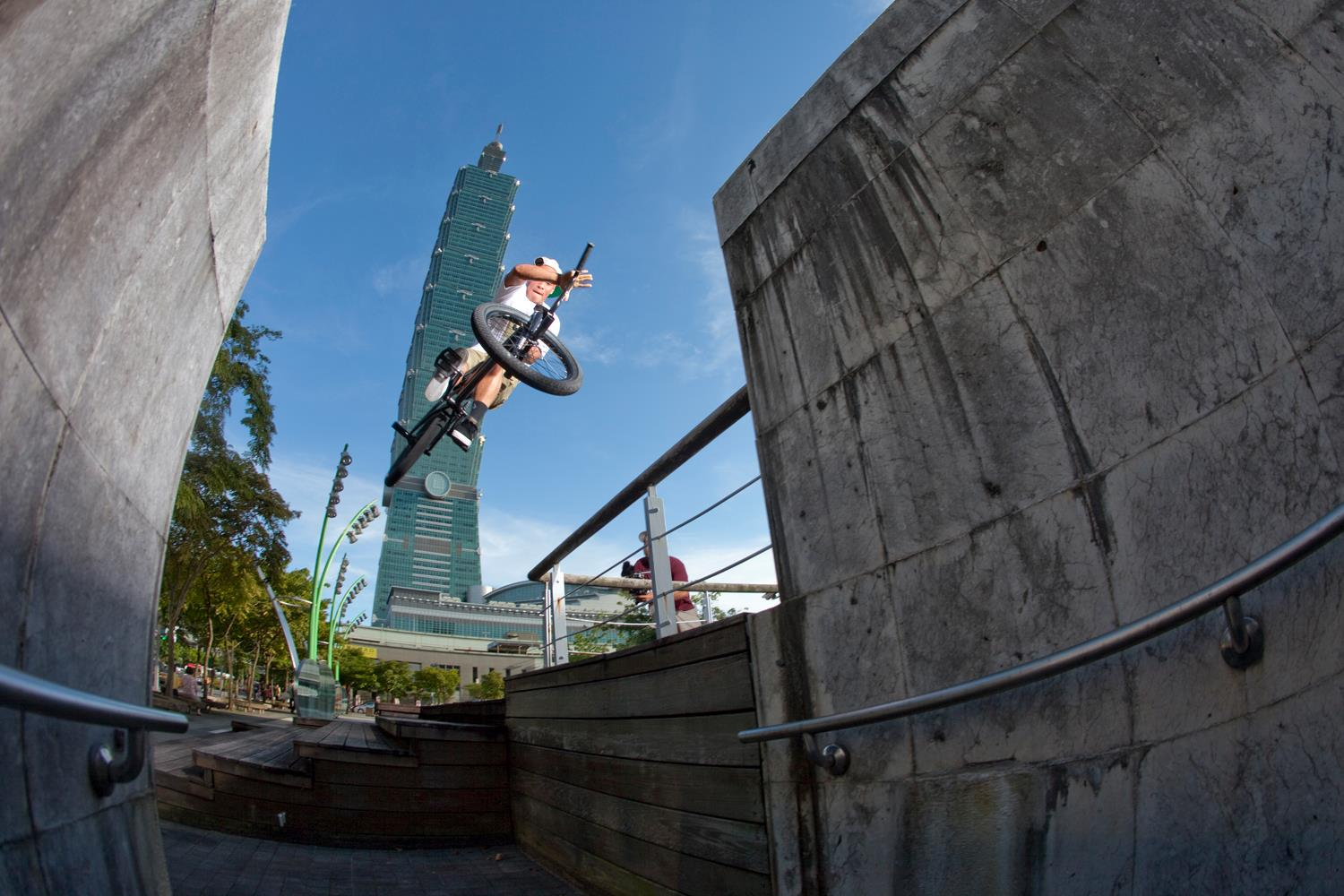 "BMX Chad Kerley fires out 180-barspin while ""warming up"" in Taipei."