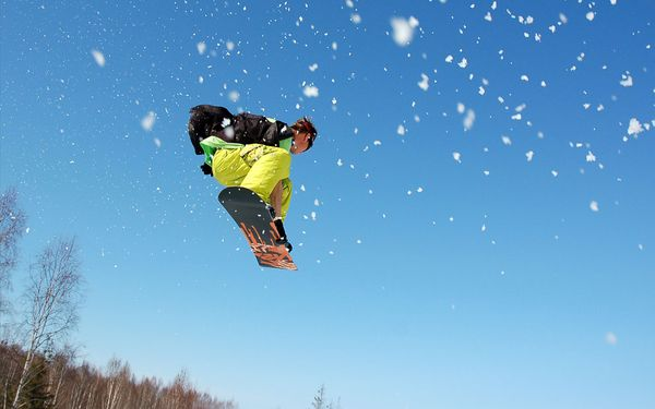 Snowboard Snowboarder flying through the air