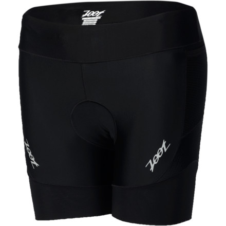 While it's not advisable to blindly follow the crowd, some things are popular for a reason. Case in point are the Zoot Performance Tri 6in Women's Shorts. Declared as the best selling women's triathlon shorts in Zoot's history, the Performance Tri delivers near-perfection in every aspect of its construction. Zoot incorporated three different fabrics for the construction of the Performance Tri shorts. And while all three materials work harmoniously towards the same objective, we're not hesitant to say that Zoot's BIOwrap provides the most pronounced results. Zoot's BIOwrap is orientated as a proprioception panel with a 240 denier spandex composition. Those are some big words, we know, so let's break them down. Starting with 'proprioception panel,' this means that the panel is designed to account for the sensations that are enacted from within the body itself. Everyone has what are called 'proprioceptors.' These are cells and nerves that emit stimuli to account for your body's position in movement. Or, in more basic terms, think of balance. Your unconscious sensory correction of staying upright is attributable to these cells. And when you're body is performing repetitive, practiced movements, their impact on the required muscle groups also become predictable. So, the BIOwrap design uses specific paneling to account for your body's internal movements. Even more impressively, over time, this localized support will train your muscle's non-visual sensory movements, and accordingly, it will enhance your body's proprioception. The shorts' other panels consist of both the Endura+ and Endura 3D fabrics. Starting with the former, this material was incorporated in order to assist in moisture management. Accordingly, it's been strategically placed in the shorts to pull moisture away from the skin and transport it to the quick-drying surface of the material. As for Endura 3D, Zoot placed this at the legs for its high levels of stretch and breathability. - $69.95