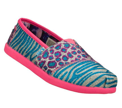 She'll capture some attention wearing the SKECHERS Bobs World III - Sparkle Safari shoe.  Soft canvas fabric upper in a wild animal glitter finish print slip on casual alpargata flat with stitching and overlay accents. - $37.00