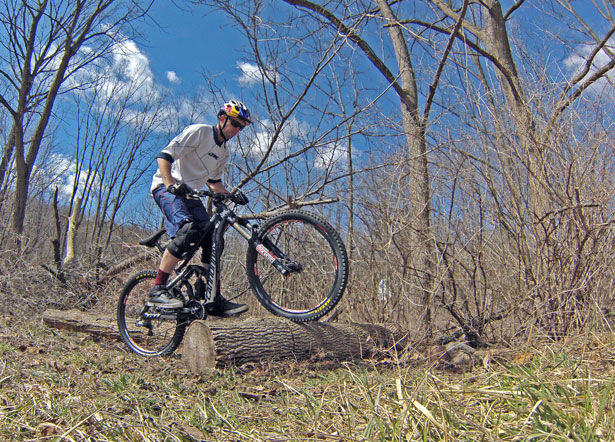 MTB Conquer Any Log in Your Path.  Aaron Chase is one of the most versatile riders of his generation. He shares his secrets for sailing over deadfall.  Article by Brian Fiske