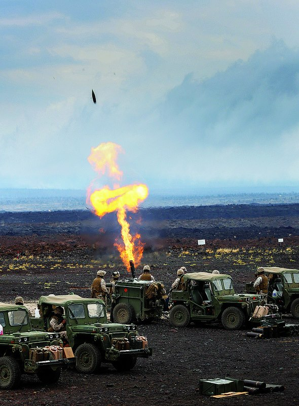 Guns and Military Marines test the Expeditionary Fire Support System M327 120mm mortar at Pohakuloa Training Area.