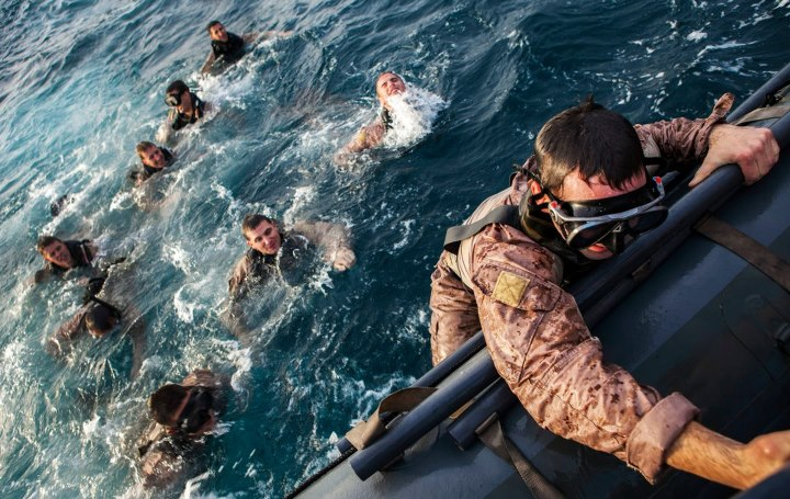 Guns and Military ALL ABOARD  26th Marine Expeditionary Unit (MEU) Maritime Raid Force Marines climb aboard a rigid hull inflatable boat after conducting scout swimming exercises at sea, April 24, 2013. Eagle Resolve is an annual multilateral exercise designed to enhance r