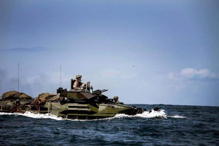 Guns and Military GREEN AMPHIBIOUS MONSTERS  U.S. Marines from Amphibious Assault Vehicle (AAV) Platoon, Battalion Landing Team 3/2, 26th Marine Expeditionary Unit (MEU), drive their AAVs from the USS Carter Hall (LSD 50) to shore during a simulated mechanized amphibious a
