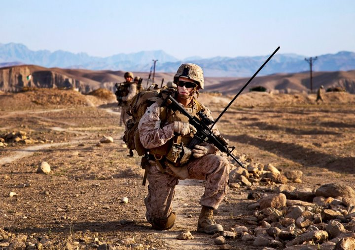 Guns and Military PATROL PAUSE  Capt. Paul Gates, commanding officer of Weapons Company, 3rd Battalion, 4th Marine Regiment, pauses during a dismounted patrol with Afghan National Civil Order Policemen (ANCOP) during Operation California in Kajaki district, Helmand provinc