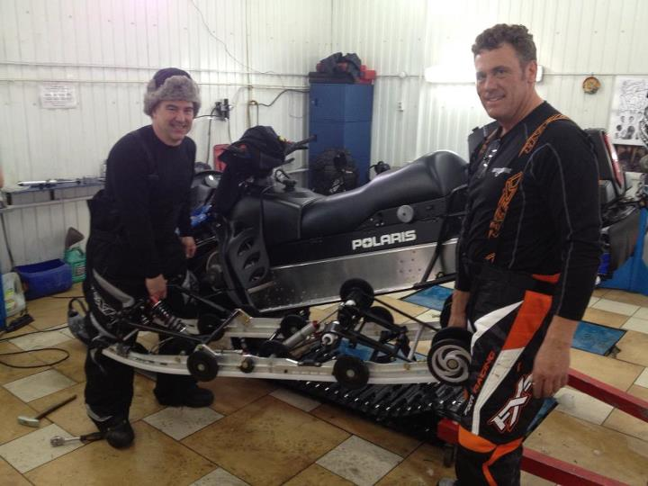 Snowmobile Prepping Paul's Polaris IQ 600 wide track for the race tomorrow in Russia.  Can you say, Walker Evans???