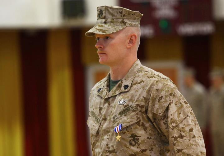 Guns and Military Marine receives the Silver Star for saving a fellow Marine and clearing paths and kicking ass while under fire.
