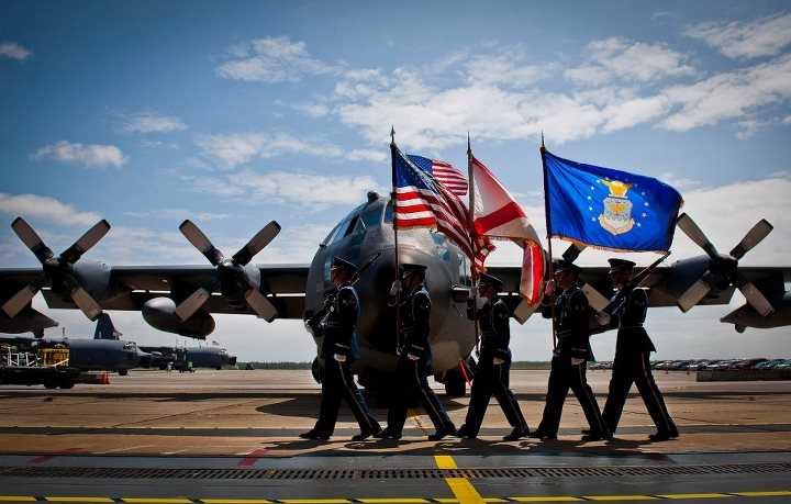 Guns and Military Check out this great photo of the Eglin Air Force Base Honor Guard presenting the colors in the shadow of an MC-130E Combat Talon I during its retirement ceremony April 25 at Duke Field, Fla.  To see the rest of this Week in Photos, visit: http://bit.ly/1