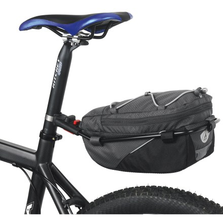 Fitness Take the weight off your back with the VAUDE Off Road saddle bike bag. Bigger than those other wimpy seat bags, the Off Road is built to carry gear for long rides without the hassle of a rear rack. Bag attaches to seatpost with an integrated luggage rack; no rear rack needed. Roomy 7-liter main compartment expands an additional 3 liters when you need even more space. Included seat post clamps accommodate posts from 25-32mm and 32-36mm. Removable shoulder strap; 2 side pockets; interior zippered pocket; removable raincover; reflective elements. Closeout. - $69.73