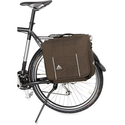 Fitness The VAUDE Camras Office bike bag easily transforms into a messenger bag, perfect for streamlining your bike-to-desk transition on mornings when you don't have a moment to spare. Bike rack attachment system offers easy, quick release from your bike; simply unroll and zip up the stowed fabric flap to hide the system when you're on foot. Recycled heavy-duty polyester fabric is weather-resistant and withstands daily wear and tear. Main zippered compartment; 2 zippered front pockets, 1 with interior organization panel; removable shoulder strap; reflective details. The VAUDE Camras Office bike bag includes a waterproof raincover. Closeout. - $79.73