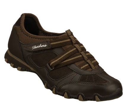 Keep the beat going in cool comfortable style with the SKECHERS Bikers - Rock Steady shoe.  Smooth leather and soft suede combine with stretch neoprene fabric and synthetic in a zigzag strap front casual slip on  with stitching and overlay accents. - $60.00