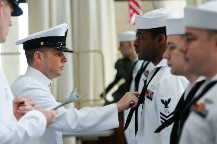 Guns and Military 130429-N-LE393-038 NEWPORT, R.I. (April 29, 2012) Senior Chief Sonar Technician (Surface) Benjamin Pierson, command senior chief at U.S. Naval War College in Newport, R.I., checks a Sailors neckerchief during a dress-white uniform inspection. (U.S. Navy p