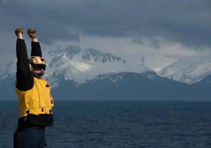 Guns and Military 130430-N-DR144-070 COOK INLET, Alaska (April 30, 2013) Aviation Boatswain's Mate (Fuel) Richard St. Clair directs the recovery of helicopters on the flight deck as the San Antonio-class amphibious transport dock ship Pre-Commissioning Unit (PCU) Anchorage