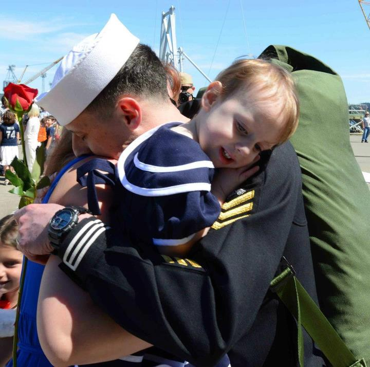 Guns and Military A sailor stationed aboard the aircraft carrier USS John C. Stennis (CVN 74) hugs his wife and child on the pier during their homecoming to Naval Station Kitsap in Bremerton, Wash. John C. Stennis is returning from an eight-month deployment to the U.S. 5th