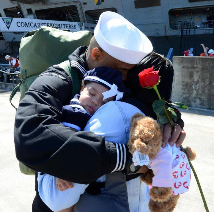 Guns and Military A sailor stationed aboard the aircraft carrier USS John C. Stennis (CVN 74) hugs his wife and daughter on the pier during their homecoming to Naval Station Kitsap in Bremerton, Wash. John C. Stennis is returning from an eight-month deployment to the U.S.