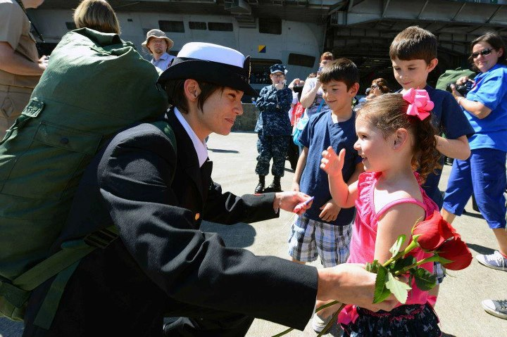 Guns and Military Chief Information Systems Technician Alexis Barnhart stationed aboard the aircraft carrier USS John C. Stennis (CVN 74) greets her family on the pier during their homecoming to Naval Station Kitsap in Bremerton, Wash. John C. Stennis is returning from an