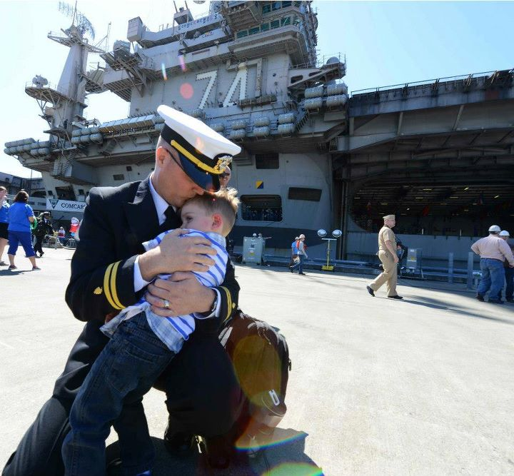Guns and Military Lt. David Elkins stationed aboard the aircraft carrier USS John C. Stennis (CVN 74) hugs his son Indiana on the pier during their homecoming to Naval Station Kitsap in Bremerton, Wash. John C. Stennis is returning from an eight-month deployment to the U.S
