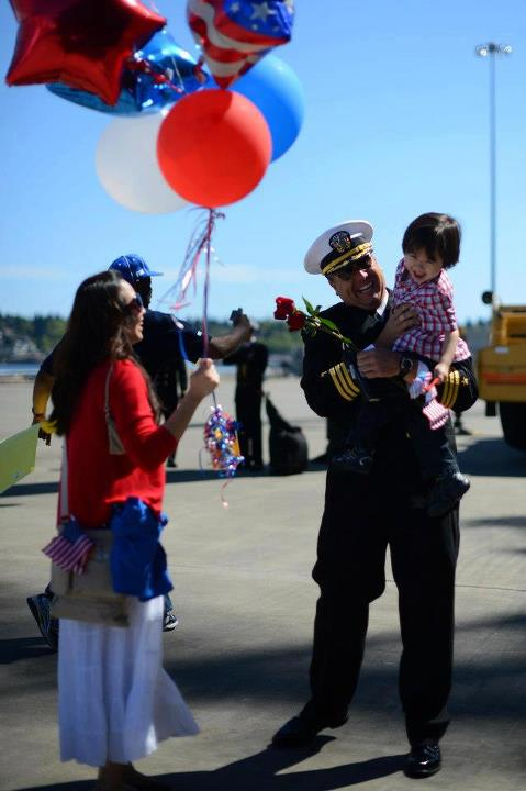 Guns and Military Lt. Cmdr. Derek Atkinson stationed aboard the aircraft carrier USS John C. Stennis (CVN 74) greets his family during their homecoming to Naval Station Kitsap in Bremerton, Wash. John C. Stennis is returning from an eight-month deployment to the U.S. 5th a