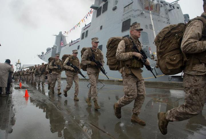 Guns and Military Marines assigned to Task Force Denali run to bring the ship to life during the commissioning of the San Antonio-class amphibious transport dock ship USS Anchorage (LPD 23) at the Port of Anchorage. More than 4,000 people gathered to witness the ship's com