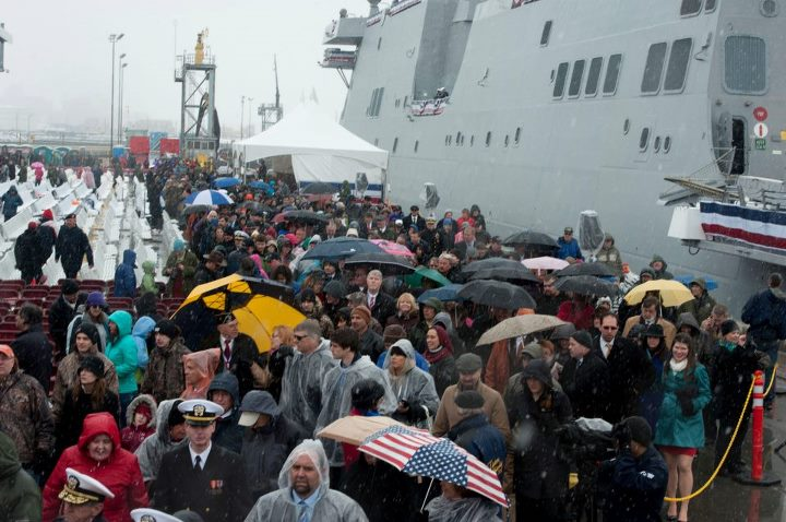 Guns and Military Guests at the commissioning ceremony for the San Antonio-class amphibious transport dock USS Anchorage (LPD 23) gather at the ship's brow to tour the ship after it was commissioned during a snow-covered ceremony at the Port of Anchorage. Anchorage is the