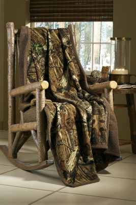 "Create the ambiance of a rustic hunting cabin with this camo-inspired throw. The remarkable contrast, depth and detail of Break-Up Infinity is what makes it so popular among hunters. Leaves, limbs, acorns and branches create a realism that breaks up a hunter s silhouette. Plush 1/2""-thick pile Sherpa fleece. Imported.Size: 50""W x 70""L. - $39.99"