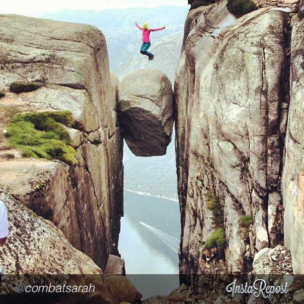 Camp and Hike Impressive jump! Kjeragbolten, the Lysefjord by @combatsarah on Instagram via #fjordnorway