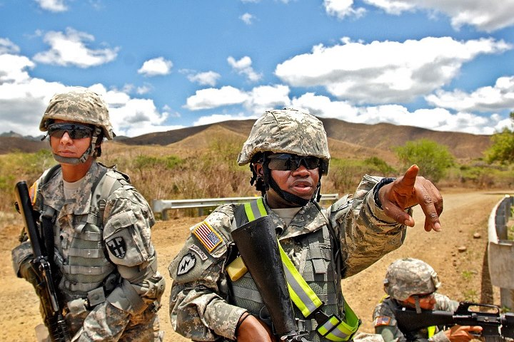 Guns and Military A Soldier points at a possible simulated attack while on a patrol during the Army's Warrior Leader Course on Camp Santiago Joint Maneuver Training Center in Salinas, Puerto Rico, April 22. The Warriors Leader Course provides training for noncommissioned o