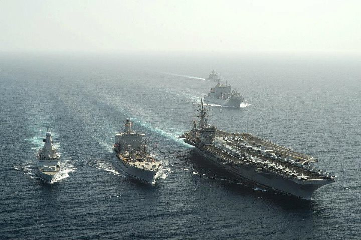 "Guns and Military We asked you to vote...and you did...a lot. Thanks to your ""likes,"" this photo of British destroyer HMS Dragon and aircraft carrier USS Dwight D. Eisenhower steaming alongside fleet replenishment oiler USNS Walter S. Diehl conducting a replenishment-at-se"