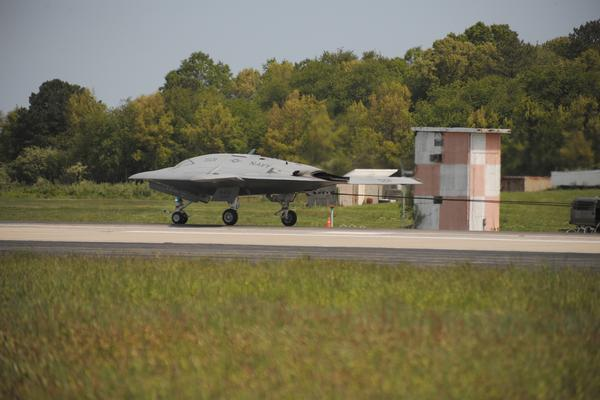 Guns and Military The Navy's X-47B Unmanned Combat Air System (UCAS) demonstrator completed its first-ever arrested landing May 4. The system is scheduled for historic carrier-based tests later this month. 
