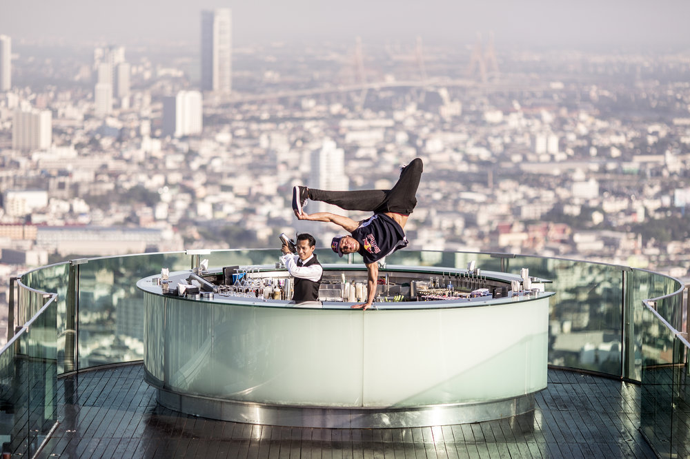 Extreme Benny Kimoto has a helping hand for the bartender of the Skybar on the 64th floor of the Lebua Hotel.