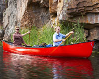 Kayak and Canoe How to Pack a Canoe - Canoe camping is a great way to experience any waterway. Article by Tim Allard