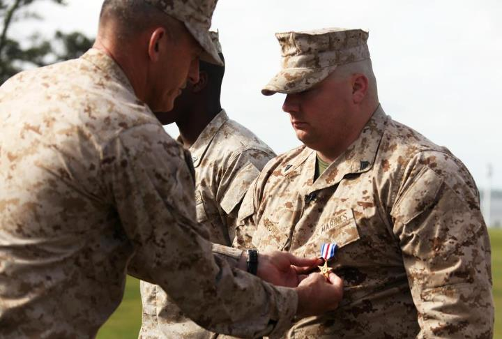 "Guns and Military Wounded warrior Marine receives the Silver Star for carrying an injured comrade more than 300 meters to a medevac while taking heavy fire.  ""If I knew the outcome was losing my legs, I would have to say I'd always do it all over again no matter what.""  Re"