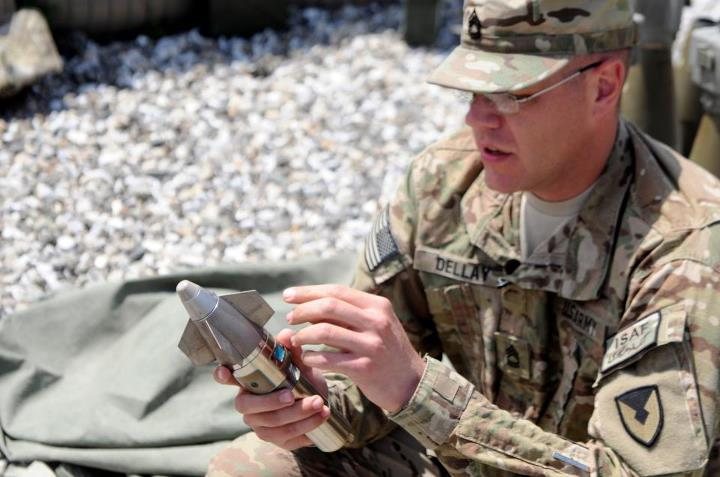 Guns and Military U.S. Army Sgt. 1st Class Brent Dellay, Fires Center of Excellence, Fort Sill, explains the various parts of a Precision Guidance Kit Net Fuse April 29, at Forward Operating Base Joyce, Kunar province, Afghanistan.
