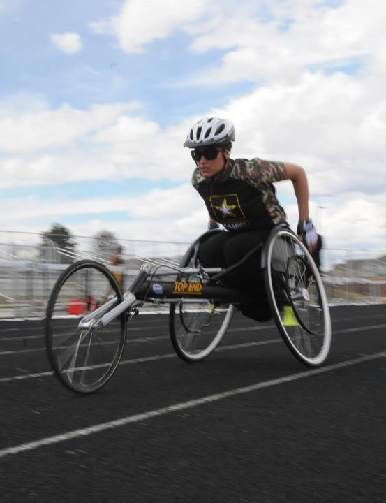 Guns and Military Spc. Elizabeth Wasil, US Army World Class Athlete Program- WCAP, practices her wheelchair race events for the Warrior Games on May 7 at Carson Middle School, U.S. Army Fort Carson. Wasil will be competing in the hand-cycling, wheelchair racing, shot-put a