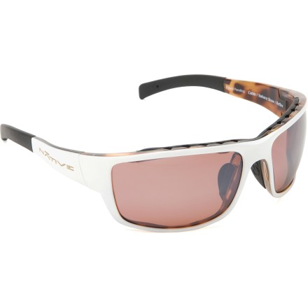 Camp and Hike The Native Eyewear Cable Reflex Polarized sunglasses feature an interchangeable lens system so you can quickly adjust for the lighting conditions as the sun plays hide and seek. Snap-Back(TM) Interchange lens system lets you switch lenses to accommodate a variety of light conditions and activities. Sahara Snow frames feature polarized copper (rose-tinted) Reflex lenses that are ideal for moderate sunlight. Iron and Gunmetal frames both feature polarized silver (gray-tinted) Reflex lenses and are ideal for extremely bright sunlight. All frames include additional SportFlex(TM) lenses for cloudy and low-light conditions. SportFlex orange-yellow lenses have a blue-mirror coating suitable for a range of low-light conditions such as cloudy, dusk or dawn. Polarized lenses reduce 99% of visible glare from water, snow, sand and pavement for increased visual acuity and decreased eye strain. Reflex lenses block 40% of infrared light to decrease eye fatigue, offer blue light filtering and 100% UV protection to minimize haze and enhance clarity. Lightweight frames are flexible and durable enough to withstand high-velocity collisions; built-in venting enhances airflow and virtually eliminates fog and condensation. The Native Eyewear Cable Reflex Polarized sunglasses are sized to best fit large-extra large profiles. Nonslip nose pads and ear stems; cam-action spring hinges. Includes a semi-hard zip case and a soft protective pouch that doubles as a cleaning cloth. Closeout. - $43.73