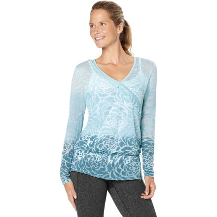 Fitness Wear the lucy Blooming Lotus soft burnout top before and after yoga class, or layer it over a cami for a look that's cool and comfortable. Soft, breathable lightweight cotton is combined with easy-care polyester. Drawcord waist can be cinched up higher near the waist or worn lower on the hips. V-neck gives way to faux-wrap front with asymmetric ruffles. - $16.73
