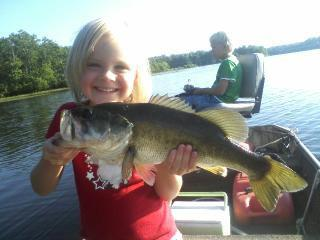 "Fishing Joel Redd says:  ""my daughter with her monster a few years ago on briery creek lake va, you dont touch her fish lol"""