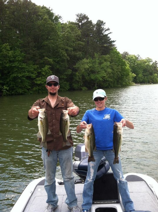 Fishing Kevin Rainey and his wife showing off some Pickwick keepers