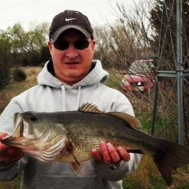 "Fishing WOS fan Brian sent in a 21"" bass he caught in Valley, NE. Nice catch!  Want to share a trophy photo? Email it to trophies@wideopenspaces.com."