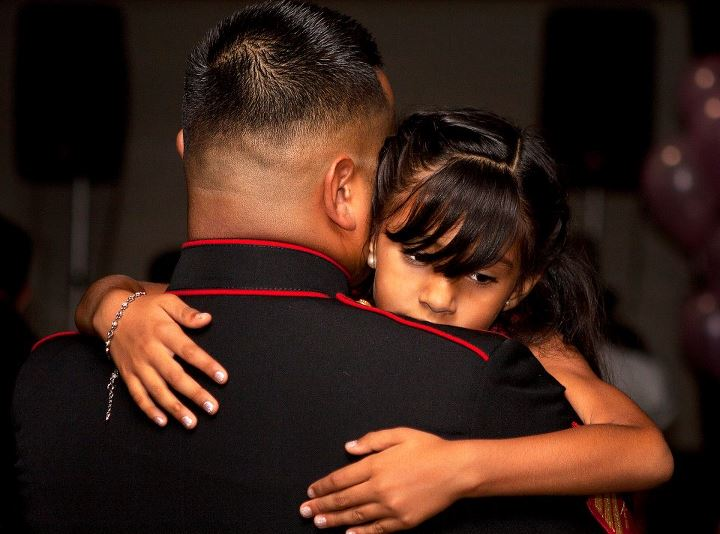 Guns and Military Daddy Daughter Dance  A young girl hugs her father while he holds her in his arms during a slow dance at the Officers' Club during the annual Father Daughter Dance on Marine Corps Base Hawaii, April 20, 2013. The dance offers the dads, who are often deplo